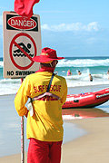 Australia, qld, queensland, surfers paradise, gold coast, beach, beaches, lifesaver, lifesavers, lifesaving, sign, signs, danger, danger sign, danger signs, warning sign, warning signs, safety, man, men, male, males, occupation, occupations, hat, hats, circle, circles, circular.