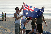 Australia, New South Wales, beach, beaches, man, men, male, males, anzac day, anzac days, beach, beaches, flag, flags, australian, australian flag, australian flags.