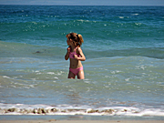 People, child, children, girl, girls, female, females, beach, beaches, surf, wave, waves, shoreline, shorelines, seashore, seashores, coast, coasts, coastal.