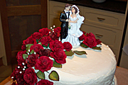 Food, cake, cakes, wedding, weddings, wedding cake, wedding cakes, icing, groom, grooms, bride, brides, rose, roses, bridegroom, bridegrooms.