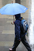 Australia, New South Wales, sydney, rain, rains, raining, wet, umbrella, umbrellas, people, pedestrian, pedestrians, road, roads, sealed, sealed road, sealed roads, man, men, backpack, backpacks.