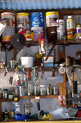 Shed, sheds, tool shed, tool sheds, paint, paints, tin, tins, paint tin, paint tins, tin of paint, tins of paint, jar, jars, glass jar, glass jars, shelf, shelves.