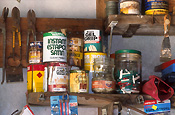 shed, sheds, tool shed, tool sheds, paint, paints, tin, tins, paint tin, paint tins, tin of paint, tins of paint, jar, jars, glass jar, glass jars, shelf, shelves, label, labels.