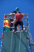 Australia, child, children, boy, boys, rope, ropes, abseil, abseils, abseiling, rope, ropes, helmet, helmets, hat, hats, outdoors, Sport pictures, Sports, descend, descends, descending, scaffold, scaffolds, scaffolding.