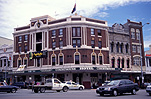 Australia, NSW, Sydney, city, cities, traffic, road, roads, sealed road, sealed roads, hotel, hotels, pub, pubs, courthouse hotel, Taylor square, Oxford Street, architecture, intersection, intersections, crossroad, crossroads.