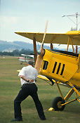 Australia, New South Wales, NSW, vintage plane, vintage planes, biplane, biplanes, bi-plane, bi-planes, transport, transportation, vehicle, vehicles, plane, planes, aircraft, aircrafts, tiger moth, tiger moths, propellor, propellors, man, men, male, males, outdoors, aeroplane, aeroplanes, light, airport, airports, aviaton, tyre, tyres.