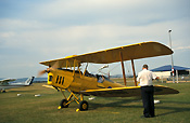 Australia, New South Wales, NSW, vintage plane, vintage planes, biplane, biplanes, bi-plane, bi-planes, transport, transportation, vehicle, vehicles, plane, planes, aircraft, aircrafts, aeroplane, aeroplanes, aviation, tiger moth, tiger moths, man, men, male, males, outdoors, light, airport, airports, blade, blades, propellor, propellors.