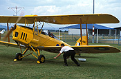 Australia, New South Wales, NSW, vintage plane, vintage planes, biplane, biplanes, bi-plane, bi-planes, transport, transportation, vehicle, vehicles, plane, planes, aircraft, aircrafts, aeroplane, aeroplanes, tiger moth, tiger moths, man, men, male, males, outdoors, aeroplane, aeroplanes, light, airport, airports, block, blocks, brake, brakes, aviation, blade, blades, propellor, propellors.