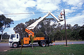 Australia, New South Wales, nsw, power, power line, power lines, power supply, electricity, telstra, telephone, telephones, telephone line, telephone lines, communication, man, men, male, males, occupation, occupations, cherrypicker, cherrypickers, cherry picker, cherry pickers, machinery, transport, transportation, vehicle, vehicles, road, roads, sealed road, sealed roads, sydney, cherry-picker, cherry-pickers.