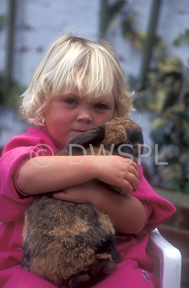 stock photo image: People, child, children, girl, girls, female, females, animal, animals, pet, pets, rabbit, rabbits, hug, hugs, hugging, cuddle, cuddles, cuddling, embrace, embraces, embracing, people and animals, children and animals, people with animals, children with animals, Australia, Sport pictures, Sports, balloon images, hot air balloons