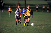 People, child, children, puberty, Sport pictures, Sports, football, footballs, football game, football games, run, runs, running, ball, balls, adolescent, adolescents, teenager, teenagers, teenage boy, teenage boys, boy, boys, male, males, soccer, soccer game, soccer games, outdoors, uniform, uniforms.