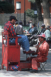 Bolivia, South America, Potosi, man, men, male, males, occupation, occupations, clean shoes, cleaning shoes, shoe shine, shoe shiner, shoe cleaner, shoe cleaners, chair, chairs.