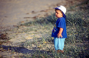 People, child, children, toddler, toddlers, boy, boys, male, males, beach, beaches, hat, hats, outdoors, beach, beaches, sand, coast, coastal.