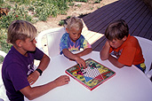 People, child, children, puberty, child, children, boy, boys, male, males, sibling, siblings, entertainment, game, games, outdoors, table, tables, chair, chairs, teenager, teenagers, teenage boy, teenage boys, board game, board games, checkers game, checkers games, checkers, chinese checkers, board game, board games.