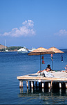Turkey, bodrum, turbuku, turbuku village, coast, coasts, coastline, coastlines, water, umbrella, umbrellas, jetty, jetties, pier, piers, sea, seas, ocean, oceans, sunbathe, sunbather, sunbathers, sunbathing.