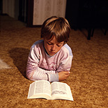 People, child, children, boy, boys, male, males, indoors, child reading, children reading, book, books, paper, read, reads, reading, book, books, paper.