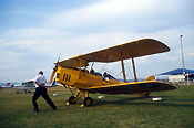 Australia, New South Wales, NSW, vintage plane, vintage planes, biplane, biplanes, bi-plane, bi-planes, transport, transportation, vehicle, vehicles, plane, planes, aircraft, aircrafts, tiger moth, tiger moths, blade, blades, propellor, propellors, man, men, male, males, outdoors, aeroplane, aeroplanes, light, airport, airports, aviation.