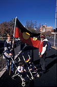 Australia, south Australia, SA, adelaide, rymill park, reconcile, reconciliation, Australian artists against racism, AAAR, Native title and reconciliation, native title, native titles, ANTAR, aboriginal, aboriginals, aborigine, aborigines, racism, racist, hand, hands, sea of hands, indigenous, indigenous people, indigenous australians, torres strait islanders, people, couple, outdoors, stroller, strollers, pram, prams, couples, flag, flags, aboriginal flag, aboriginal flags, aboriginal.