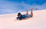 Australia, qld, queensland, moreton, moreton island, teenager, teenagers, adolescent, adolescent, boy, boys, male, males, people, child, children, puberty, teenage boy, teenage boys, dune, dunes, sand dune, sand dunes, beach, beaches, sand, toboggan, toboggans, tobogganing, hat, hats.
