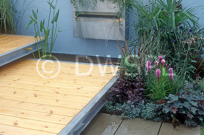 Garden scene featuring timber decking with steps and wall for Garden decking features