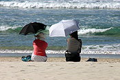 Australia, qld, queensland, surfers, surfers paradise, gold coast, beach, beaches, coast, coasts, coastal, coastline, coastlines, woman, women, female, females, umbrella, umbrellas.