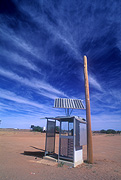 Australia, australian outback, outback australia, desert, deserts, Outback, telephone, telephones, communication, phone, phones, telephone box, telephone boxes, solar, solar power, solar powered, solar telephone, solar telephones, solar energy, sky, skies, blue sky, blue skies, cloud, clouds.