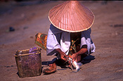 Asia, Asian, Southeast Asia, South East Asian, SE Asia, malaysia, people, woman, women, female, females, fish, fishing, hat, hats, basket, baskets, beach, beaches.