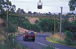 Road, roads, sealed road, sealed roads, power, power line, power lines, power supply, electricity, pulley, pulleys, goods pulley, goods pulley, australia, car, cars, vehicle, vehicles, kandos, new South Wales, nsw, australia, motor car, motor cars, bend, bends.