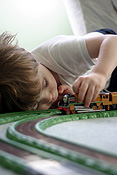 Child, children, girl, girls, female, females, male, males, boy, boys, train, trains, train set, train sets, indoors, track, tracks, train track, train tracks, PJ38,