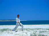 People, man, men, male, males, outdoors, karate, Sport pictures, Sports, beach, beaches, coast, coasts, coastline, coastlines, seashore, seashores, shoreline, shorelines, uniform, uniforms, exercise, exercises, exercising, qld, queensland, australia, martial arts.
