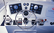Transport, transportation, vehicle, vehicles, boat, boats, boating, wheel, wheels, steering, steering wheel, steering wheels, dashboard, dashboard, boat dashboard, boats dashboard, compass, compasses, speed boat, speed boats, motor boat, motor boats, Royalty Free Image