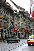 Europe, Switzerland, Swiss, Bern, Berne, Architecture, medieval, street, streets, clock, clocks, flag, flags.