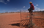 Australia, Australian, Australian desert, Australian deserts, shadow, shadows, Man, Men, Male, Males, people, Fence, Fences, desert, deserts, desert scenes, outback, australian outback, outback australia, NT, Northern Territory, Australia, hat, hats, outdoors.